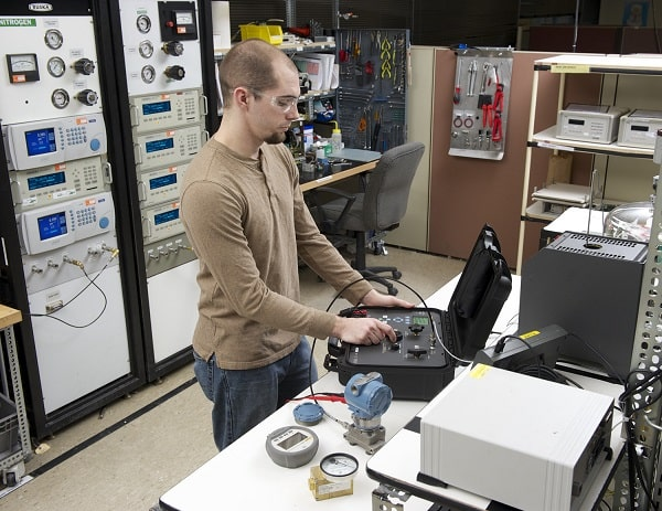 Technician Performing an Equipment Verification vs Calibration with Same Calibrator