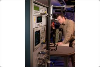 Fluke 6.5 Digit DMM in Rack with Technician