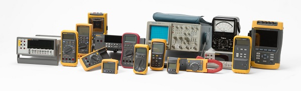 Array of digital multimeters and other test equipment